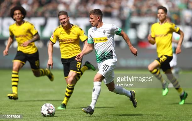 Thorgan Hazard of Moenchengladbach runs with the ball during the Bundesliga match between Borussia Moenchengladbach and Borussia Dortmund at...