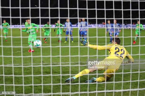 Thorgan Hazard of Moenchengladbach scores a goal from he penalty spot past Rune Jarstein of Berlin to make it 02 during the Bundesliga match between...