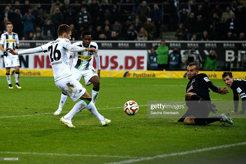 Thorgan Hazard of Moenchengladbach scores his team's third goal during the Bundesliga match between Borussia Moenchengladbach and Hertha BSC Berlin at Borussia Park Stadium on December 6, 2014 in Moenchengladbach, Germany.