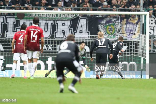Thorgan Hazard of Moenchengladbach scores penalty shot to make it 21 during the Bundesliga match between Borussia Moenchengladbach and Hannover 96 at...