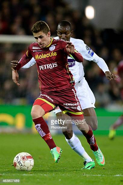 Thorgan Hazard of ZulteWaregem is challenged by Sekou Cisse of KRC Genk during the Jupiler League match between SV Zulte Waregem and KRC Genk in the...