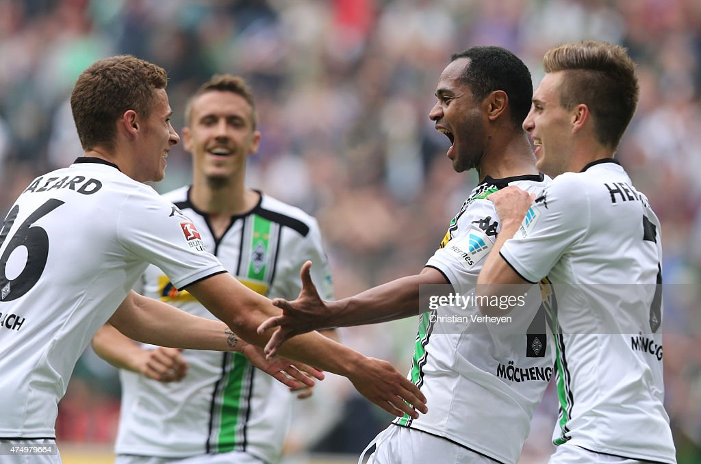 Thorgan Hazard, Raffael and Patrick Herrmann of Borussia Moenchengladbach celebrate after the first goal during the Bundesliga match between Borussia Moenchengladbach and FC Augsburg at Borussia Park Stadium on May 23, 2015 in Moenchengladbach, Germany.