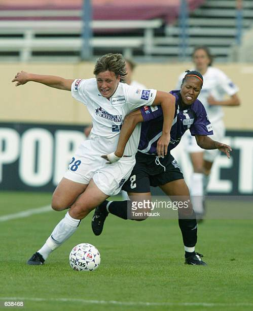 Thori Bryan of the San Jose CyberRays fights for the ball against Abby Wambach of the Washington Freedom during the first half of their WUSA match...