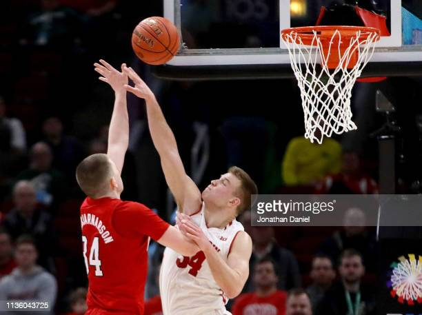 Thorir Thorbjarnarson of the Nebraska Huskers attempts a shot while being guarded by Brad Davison of the Wisconsin Badgers in the second half during...