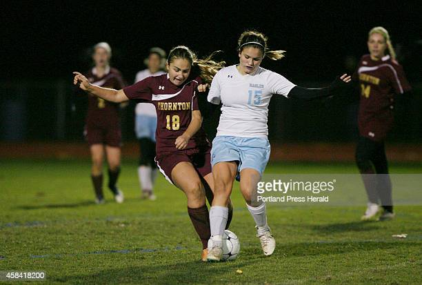 Thornton Academy Captain Katharine Senechal left battles with Windham's Ciera Berthiaume right during overtime of their game Monday Nov 3 2014 in...
