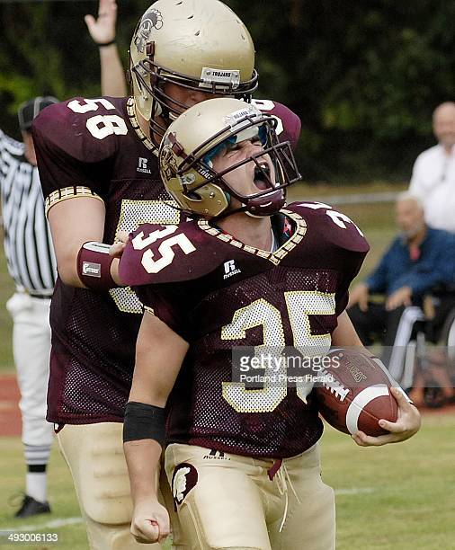 Thornton Academy's Adam Lamontagne celebrates a touchdown with teammate Keith Parenteau Friday Sept 3 2010