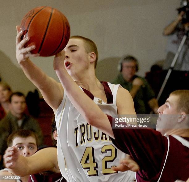 Thornton Academy's Justin Pollard goes up for a rebound against Windham Thursday Jan 28 2010