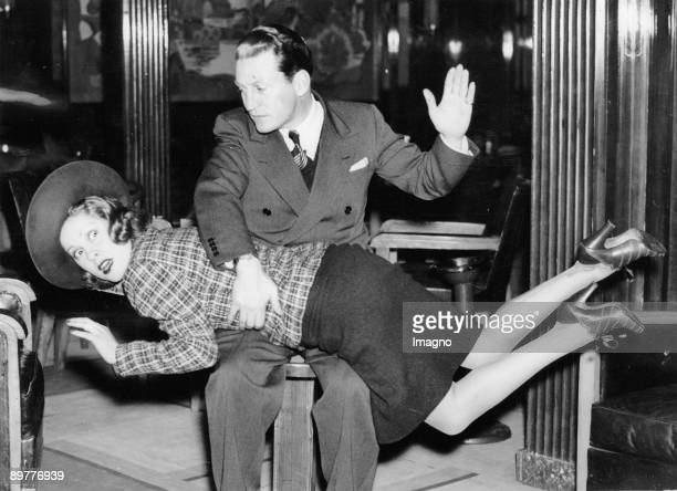 Thornton Freeland gives his wife June Clyde a spanking Photograph March 19th 1938