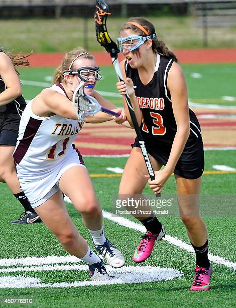 Thornton Tatum Leclair defends as Biddeford Melissa Huot heads to the goal as Thornton Academy hosts Biddeford in girls lacrosse quarter finals game