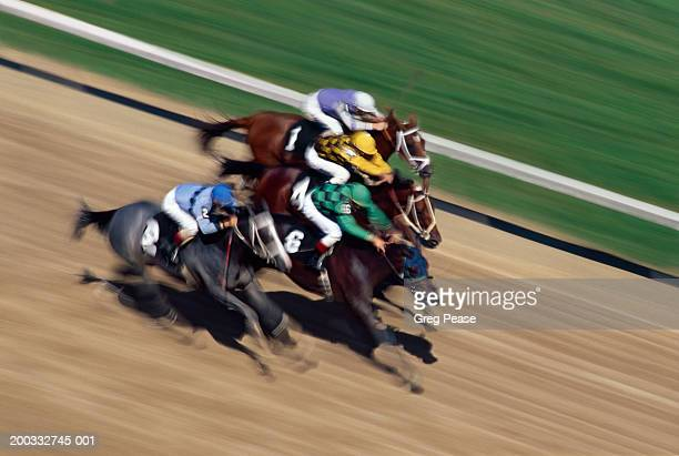 thoroughbred horse race on track (digital enhancement, blurred motion) - thoroughbred_horse_racing stock pictures, royalty-free photos & images