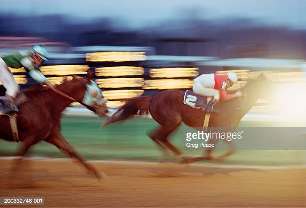 thoroughbred horses approaching finish line (blurred motion) - thoroughbred_horse_racing stock pictures, royalty-free photos & images