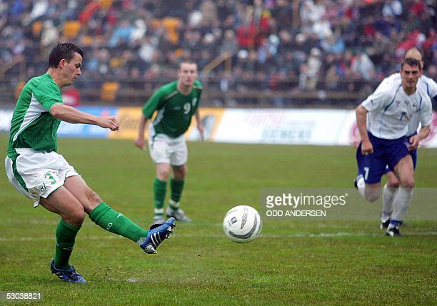 Ian Harte of Ireland scores a penalty kick to make it 10 against Faroe Islands during their World Cup 2006 qualifier match at Torsvoellur stadium in...
