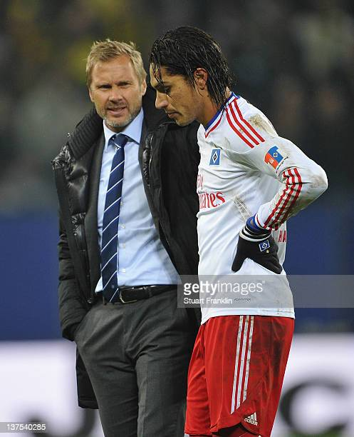 Thorsten Fink head coach of Hamburg and Paolo Guerrero look dejected at the end of the Bundesliga match between Hamburger SV and Borussia Dortmund at...