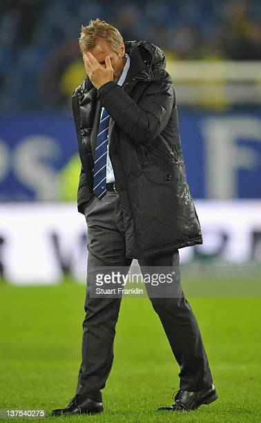 Thorsten Fink, head coach of Hamburg looks dejected at the end of the Bundesliga match between Hamburger SV and Borussia Dortmund at Imtech Arena on...