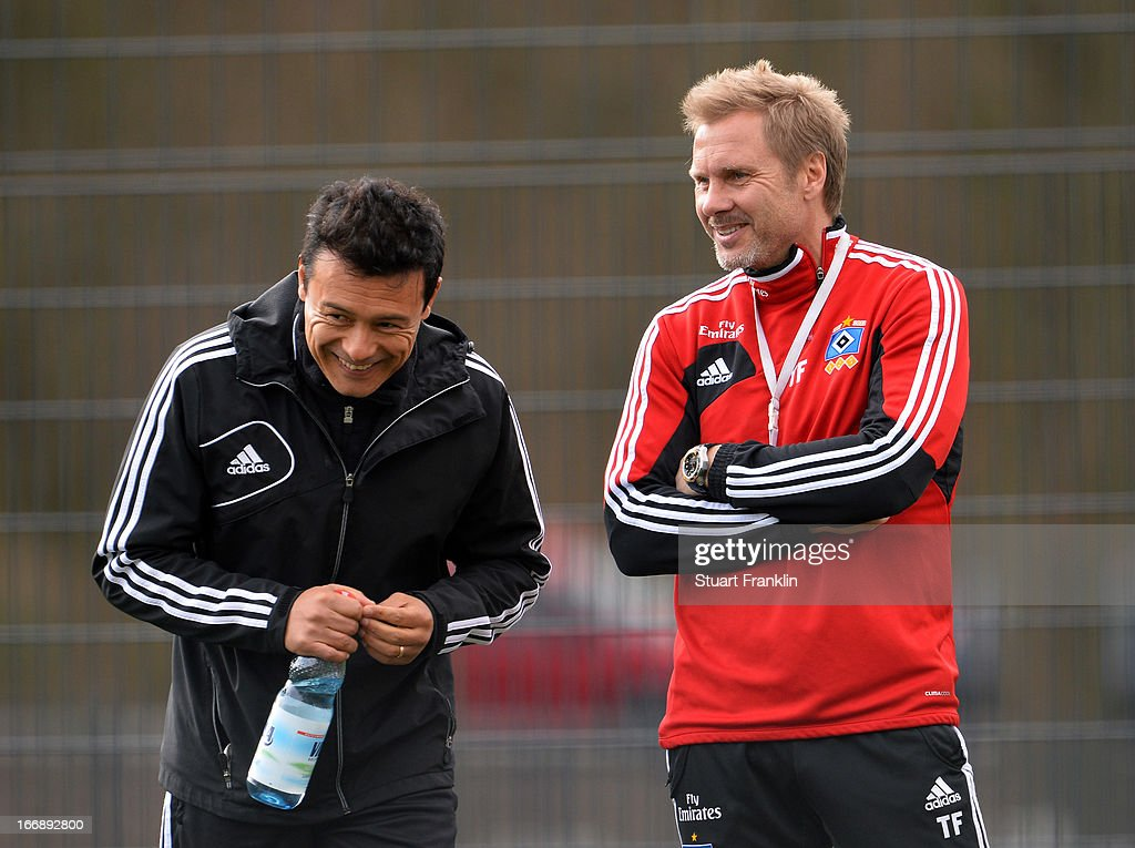 Thorsten Fink, head coach of Hamburg talks with under 23 coach, Rodolfo Cardoso during a training session of Hamburger SV on April 18, 2013 in Hamburg, Germany.