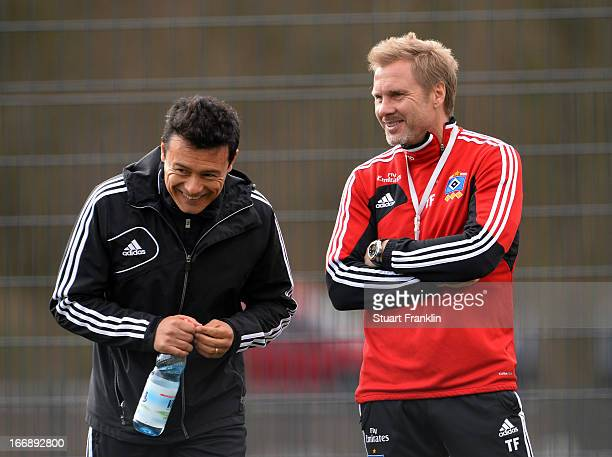 Thorsten Fink head coach of Hamburg talks with under 23 coach Rodolfo Cardoso during a training session of Hamburger SV on April 18 2013 in Hamburg...