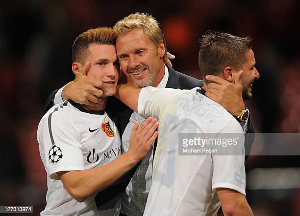 Thorsten Fink manager of Basel celebrates with Taulant Xhaka and Markus Steinhofer after the UEFA Champions League Group C match between Manchester...