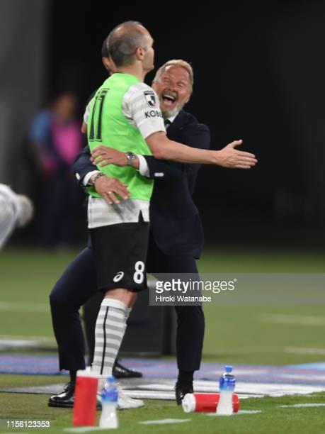Thorsten Fink,coach of Vissel Kobe and Andres Iniesta of Vissel Kobe celebrate the win after the J.League J1 match between FC Tokyo and Vissel Kobe...