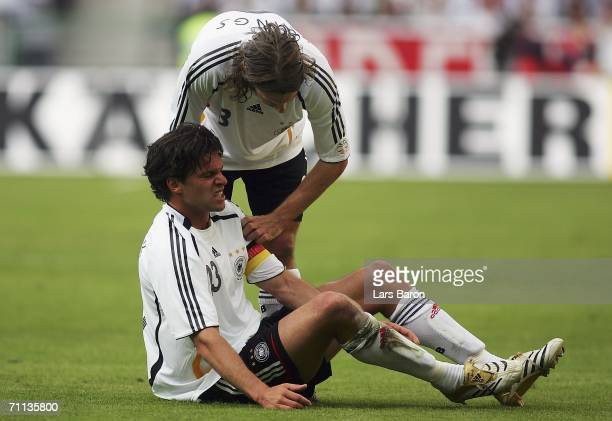 Thorsten Frigs looks at injured Michael Ballack during the international friendly match between Germany and Colombia at the Borussia Park on June 2...