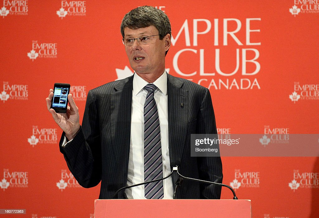 "Thorsten Heins, chief executive officer of BlackBerry, displays a Z10 device while speaking during an event at the Empire Club of Canada in Toronto, Ontario, Canada, on Tuesday, Feb. 5, 2013. Heins said early sales of the Z10 smartphone are ""encouraging"" and that users are switching from other platforms. Photographer: Aaron Harris/Bloomberg via Getty Images"
