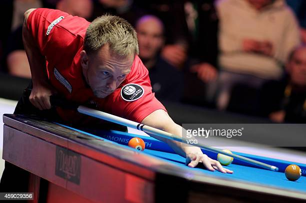 Thorsten Hohman of Germany plays a shot against Nikos Ekonomopoulos of the Hellenic Republic on day one of the Partypoker World Pool Masters 2014 at...