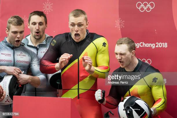 Thorsten Margis and Francesco Friedrich of Germany react as they watch the final run by Justin Kripps and Alexander Kopacz of Canada during the Men's...