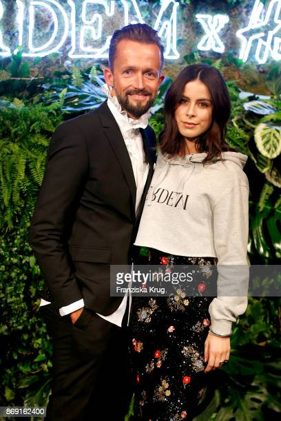 Thorsten Mindermann and singer Lena MeyerLandrut wearing ERDEM X HM attend the ERDEM x HM PreShopping Event on November 1 2017 in Berlin Germany