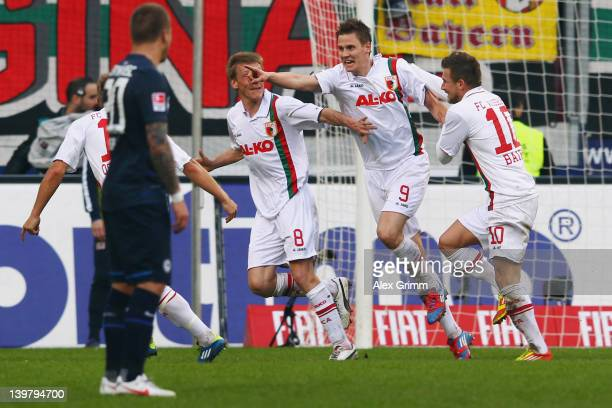 Thorsten Oehrl of Augsburg celebrates his team's second goal with team mates Matthias Ostrzolek, Axel Bellinghausen and Daniel Baier as Patrick Ebert...