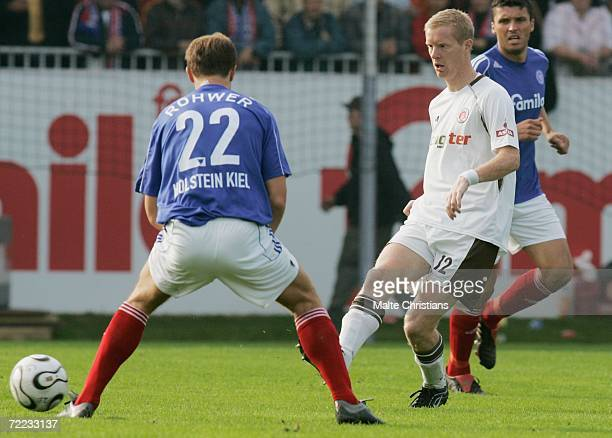Thorsten Rohwer of Holstein Kiel competes with Timo Schulz of Pauli during the third league match between Holstein Kiel and FC St Pauli at the...