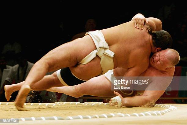 Thorsten Scheibler from Germany fights against Robert Paczkow from Poland during the World Games 2005 Sumo Competition on July 19 2005 in Duisburg...