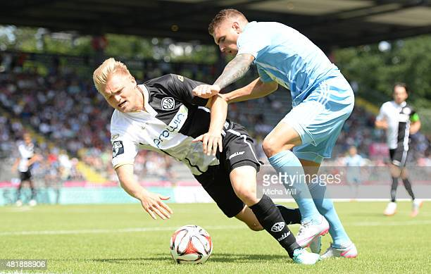 Thorsten Schulz of Aalen and Christian Cappek of Chemnitz tussle for the ball during the Third League match between VfR Aalen and Chemnitzer FC at...