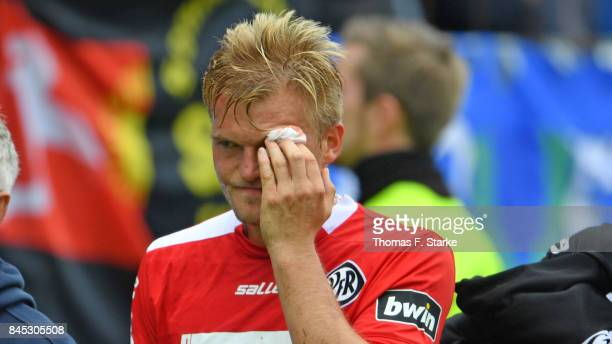 Thorsten Schulz of Aalen leaves the pitch injured during the 3 Liga match between SV Meppen and VfR Aalen at Haensch Arena on September 10 2017 in...