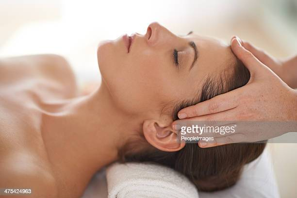those hands are bringing her the relief she needs - head massage stock photos and pictures