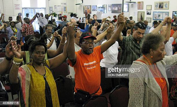 Those in attendance sign and pray at the House of Justice August 16 2014 in New York The Reverend Al Sharpton addressed what he called a smear...