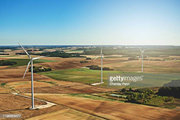 those turbines love to spin - carbon footprint stock pictures, royalty-free photos & images