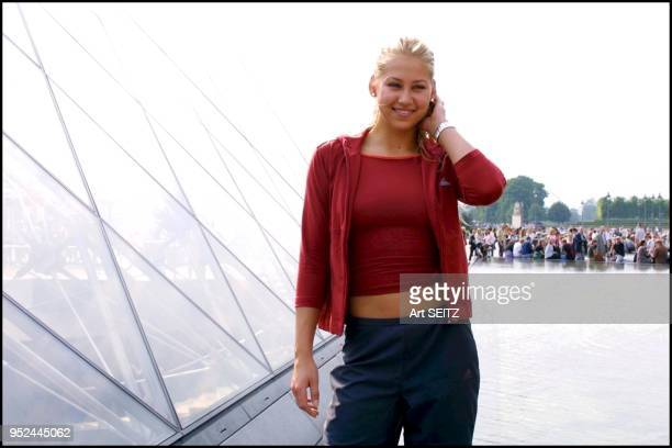 Though not playing at the French Open this year Russian tennis star and beauty Anna Kournikova consented to a photo call at the pyramid entrance of...