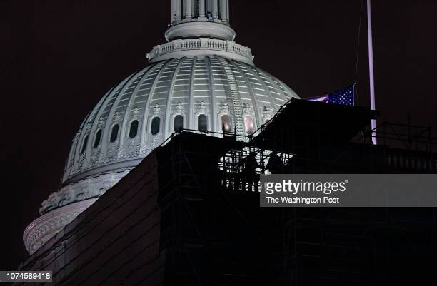 Though the the congress and staff had left earlier Thursday night construction workers were still installing scaffolding well past midnight into...