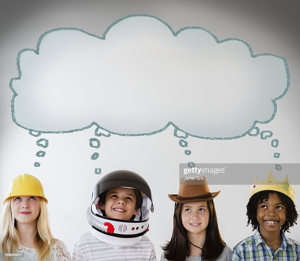 Thought bubble above kids wearing costumes : Stock Photo