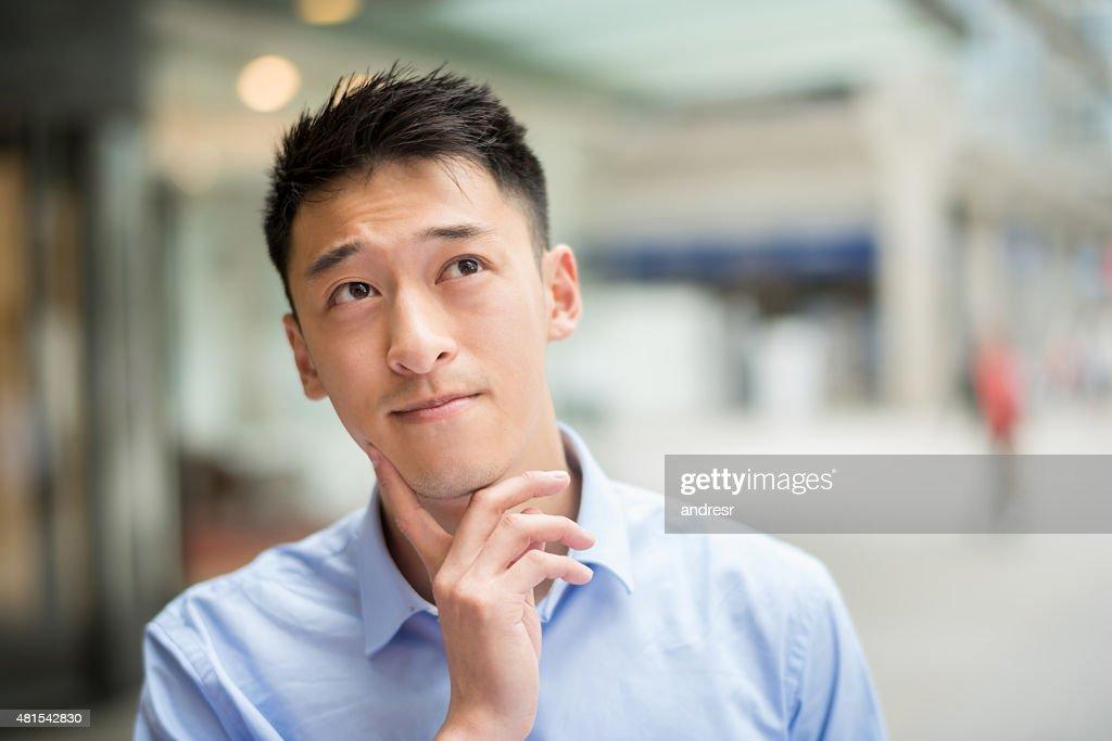 Thoughtful Asian business man : Stockfoto