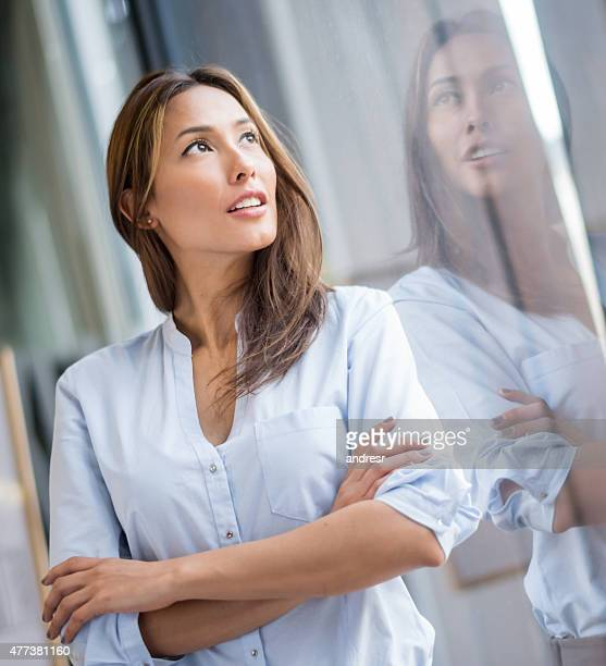 Thoughtful Asian business woman
