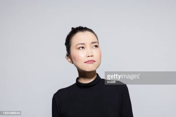 thoughtful asian young woman - izusek stock pictures, royalty-free photos & images