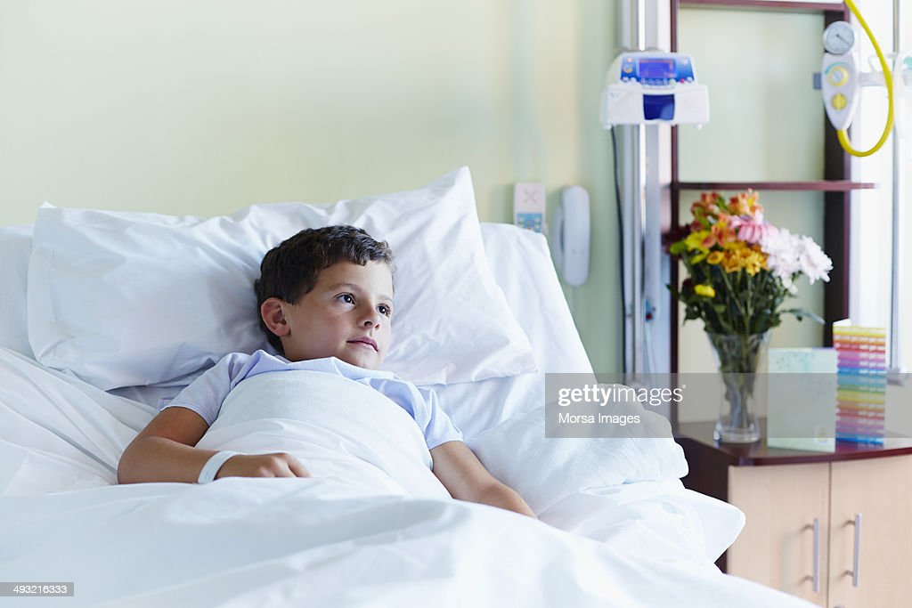Thoughtful boy relaxing in hospital : Stock Photo