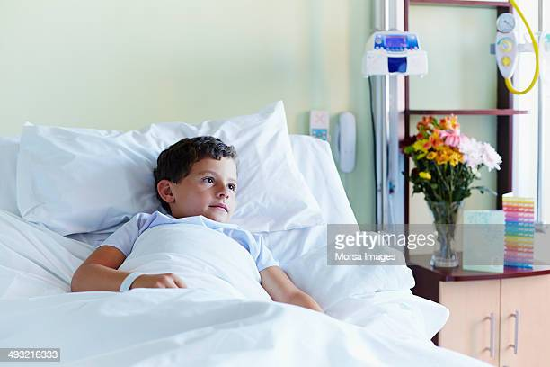 Thoughtful boy relaxing in hospital