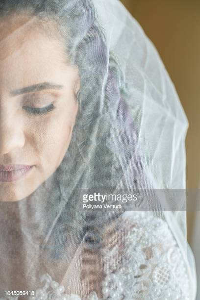 thoughtful bride - wedding veil stock photos and pictures