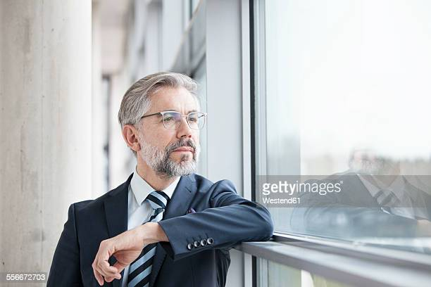 Thoughtful businessman looking out of window