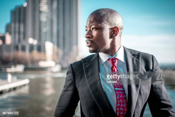 thoughtful businessman on the go - multi colored suit stock photos and pictures