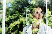 Thoughtful businesswoman by glass window