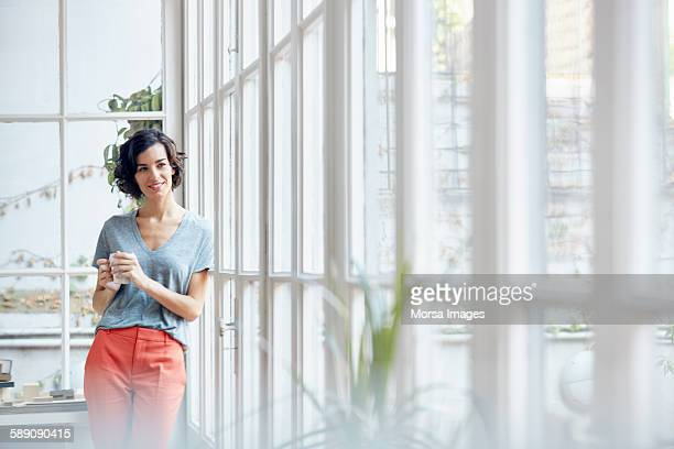 Thoughtful businesswoman by office window
