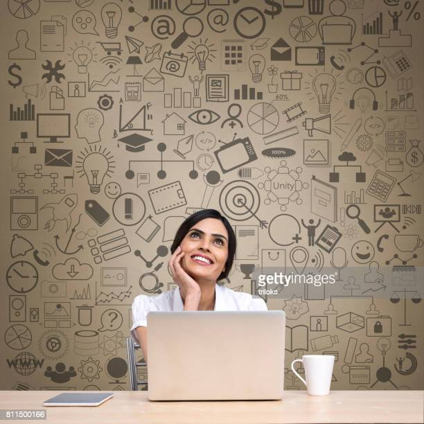thoughtful businesswoman with laptop at office desk - people icons stock pictures, royalty-free photos & images