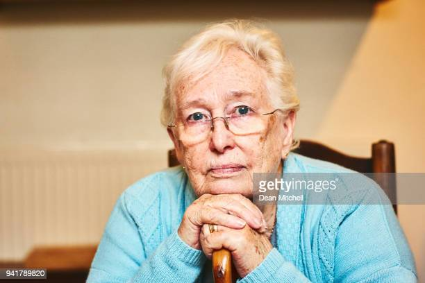 Thoughtful elderly woman staring at camera